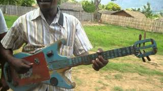 Makeshift Mozambican Guitar - after church service