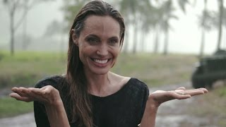 EXCLUSIVE: Angelina Jolie Gets Caught in the Rain Behind the Scenes of