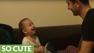 Baby laugh hysterically at dad's funny antics