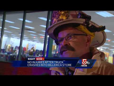 Truck slams into store in popular shopping plaza