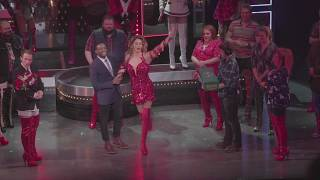 Callum Francis hands the Kinky Boots to Kayi Ushe