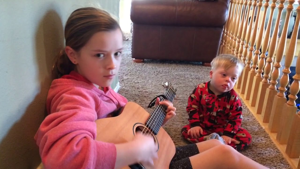 "Lydia sings to her Down Syndrome brother Bo ""you are my sunshine"""