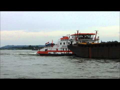 Germany: A push tug unit with four dumb barges on the river Rhine