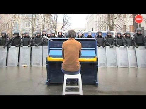 Playing the piano to riot police in Ukraine - #BBCTrending - BBC News
