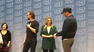 Elizabeth Olsen, Tom Hiddleston, and Chris Evans doing group photos at ACE