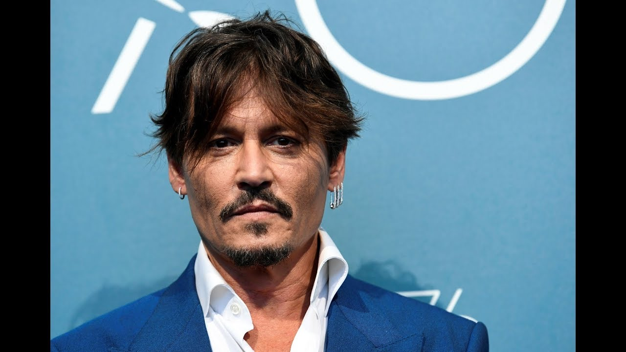 Johnny Depp jokes about his drinking at Venice film festival