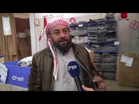 افتتاح سوقاً لتوزيع الألبسة على النازحين في ريف إدلب الشمالي كفرتخاريم  - 15:21-2018 / 2 / 22