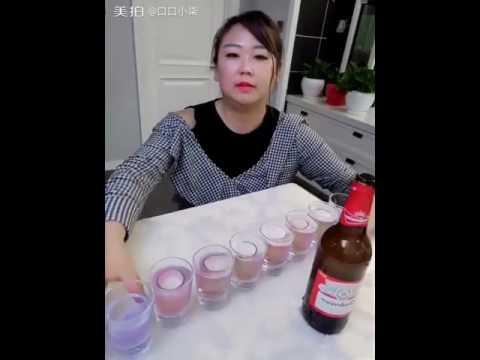 Chinese girl doing shots