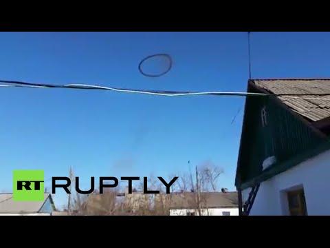 Smoke machine? Portal to hell? Mysterious black ring in sky baffles Kazakh village