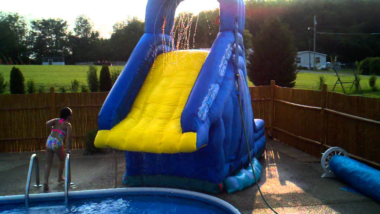 Crazy fun on the inflatable banzai blaster pool slide in - How to build a swimming pool slide ...