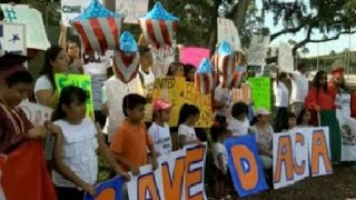 Protesters march through downtown Clearwater in defense of DACA, 'Dreamers' Dozens of protesters marched through downtown Clearwater to spread a message, using their voices and signs as a way to rally support., From YouTubeVideos
