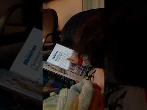 Sam reading to Mama five years old