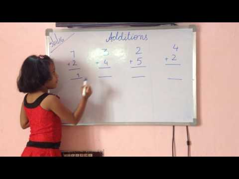PP II (UKG) Student solving 'additions concept' on board