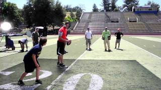 Emmett Berg and Tom Brady playing catch