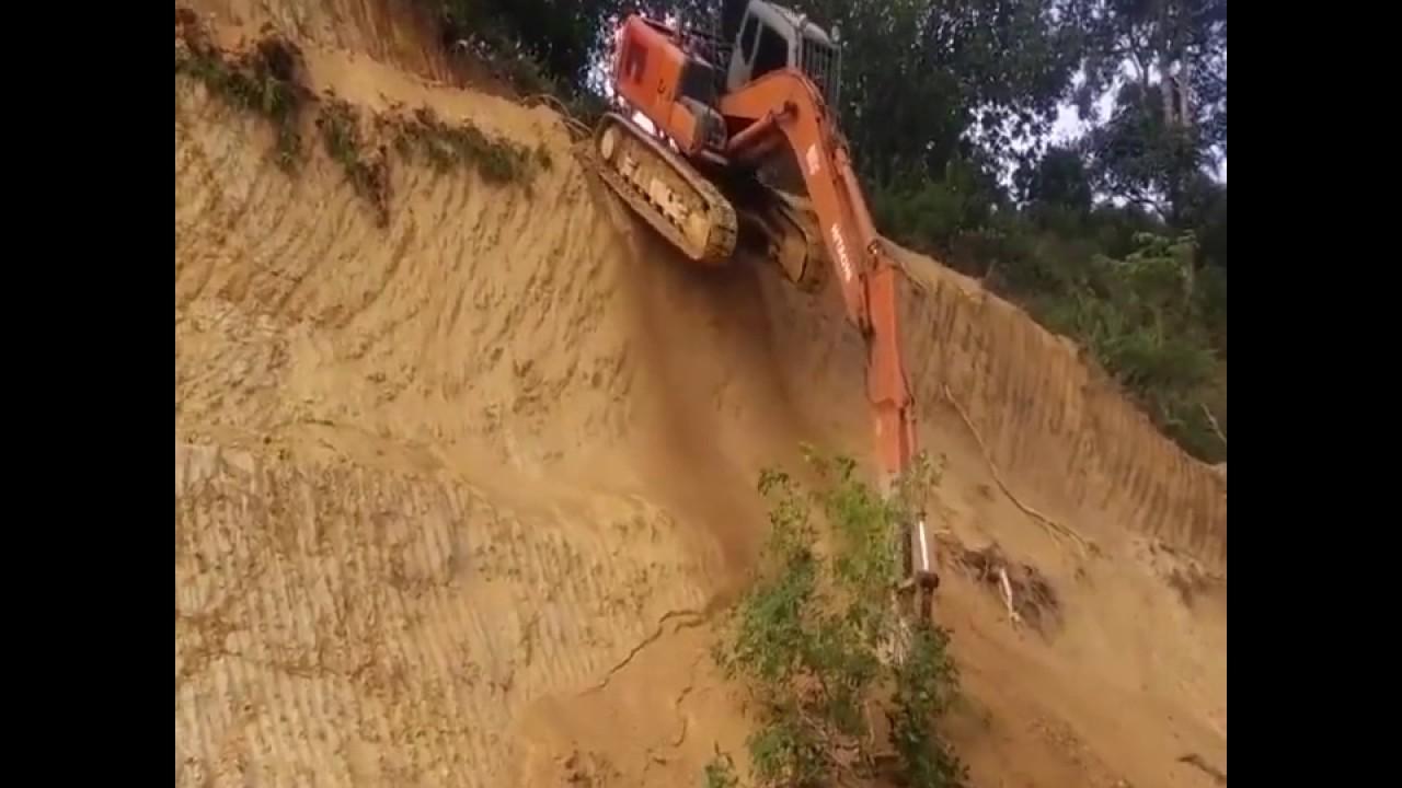 Excavator Moving Downhill