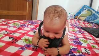 4 months baby activity - playing with headphones