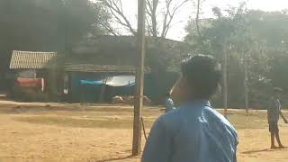 Cricket playing in school ground with students