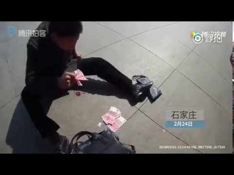 Man suffers heart attack outside train station, scatters cash to get someone tohelp