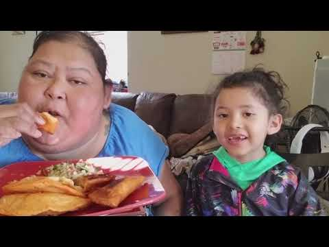 Eating ground beef, potatoes, and rice filled empanadas and salad with my granddaughter