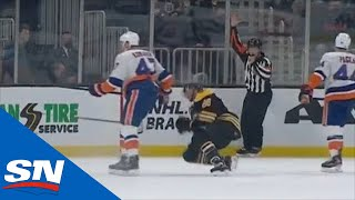 Leo Komarov Drops David Pastrnak With The Butt End Of His Stick