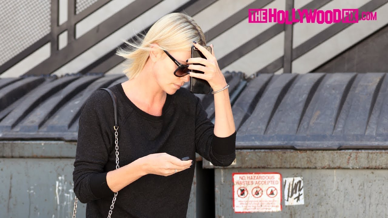Charlize theron tries to hide from paparazzi while leaving for 901 salon west hollywood