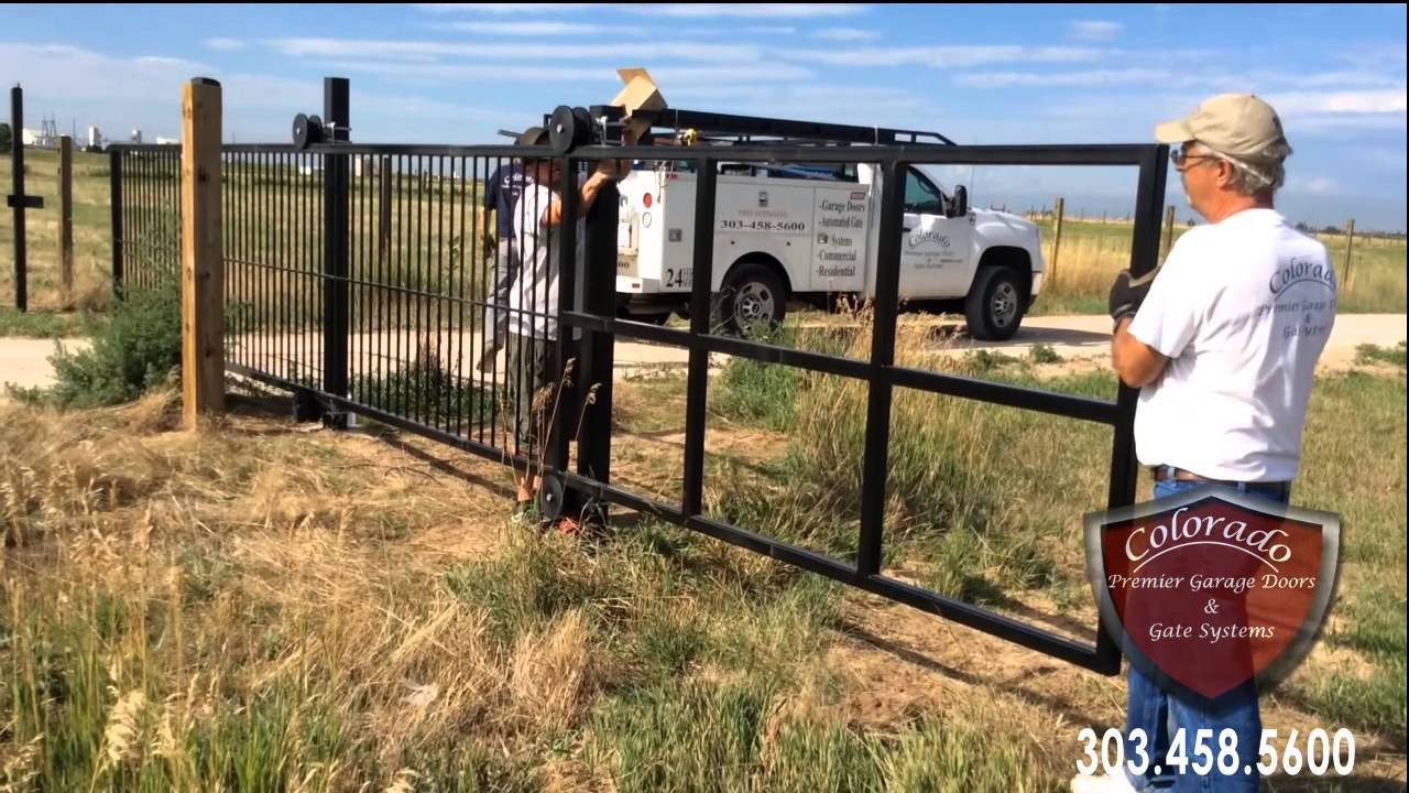 Denver cantilever driveway gate installation youtube for How to build a driveway gate
