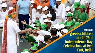 PM Modi greets children at the 73rd Independence Day Celebrations at Red Fort, Delhi