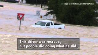 Driver Ignores Barriers and Drives into Flooded Road—Watch What Happens