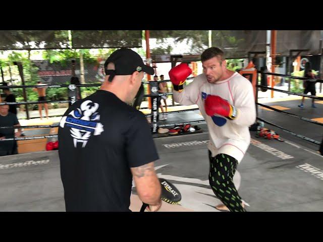 Anatoly Malykhin on boxing paddles with coach John Hutchinson