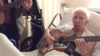 Guitarist George Cole jams with his old guitar teacher in hospital.