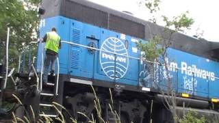 Pan Am Railways train AYWA shifting, starting a locomotive and passing by.