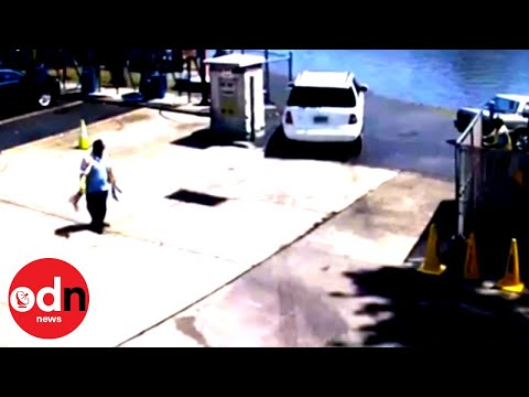 Driver Forgets to Brake at Car Wash and Plunges into River