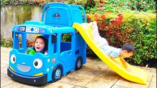 The twins play with Tayo Little Bus