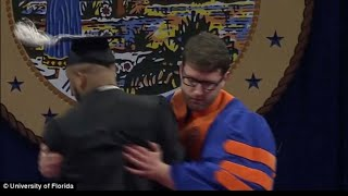 Video shows University of Florida black students pulled off stage during graduation for celebrating