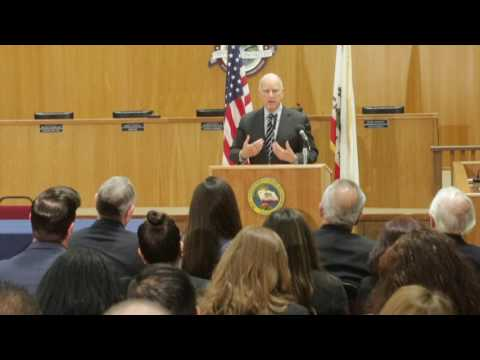 Gov. Jerry Brown signs a bill helping four local cities