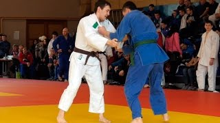 Young athletes judoists fight in judo competitions