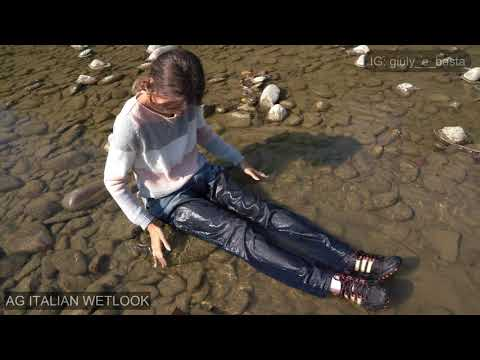 Wetlook - Giulia into the river fully clothed in black sneakers