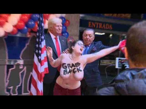 Feminist activist flashes breasts as protest against Trump in Madrid thumbnail