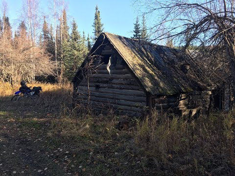 Riding to explore the old gold rush cabin in Alaska