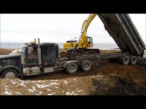 Trucks Dumping Muck from Dredging Project