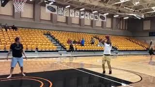 Ex-Razorback Star Anthlon Bell nails half court shot during skills challenge