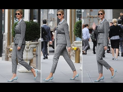 Ivanka Trump models a grey tweed pantsuit and lacy blue heels as she steps out of her New York home
