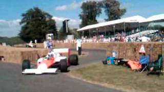 goodwood festival of speed 2010 jenson button and other formula 1 cars returning to paddock