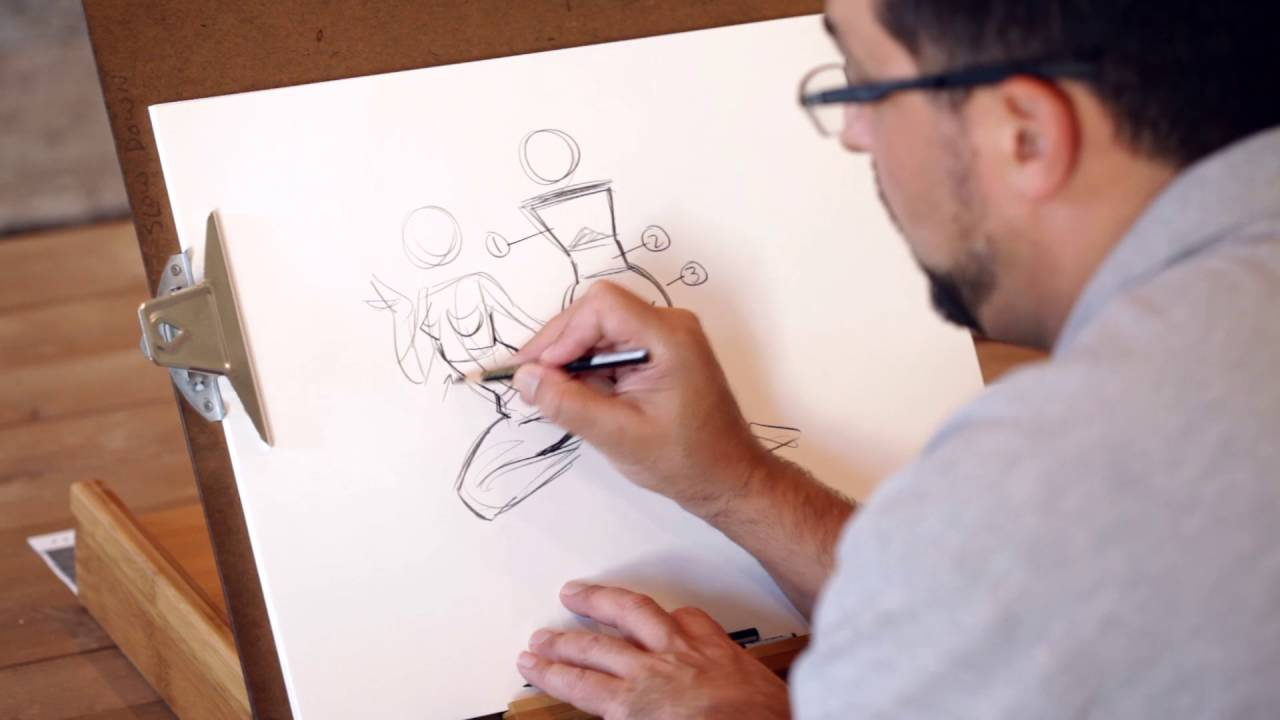 The picture above shows a man drawing in the studio.