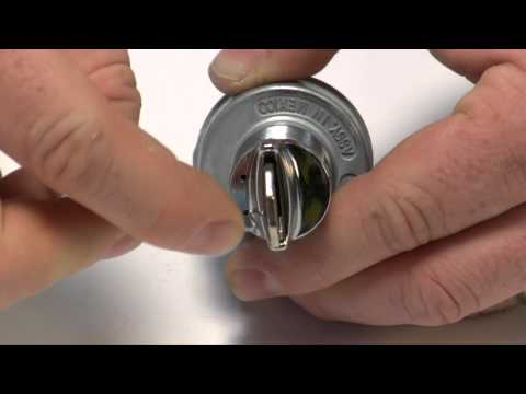 Removing a key lock and tumbler from a GM-style ignition switch.
