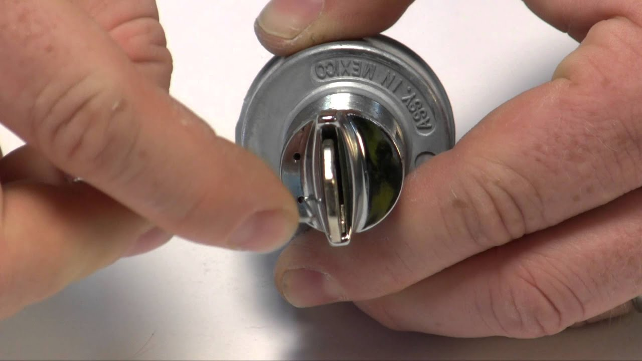 removing a key lock and tumbler from a gm style ignition switch  [ 1280 x 720 Pixel ]