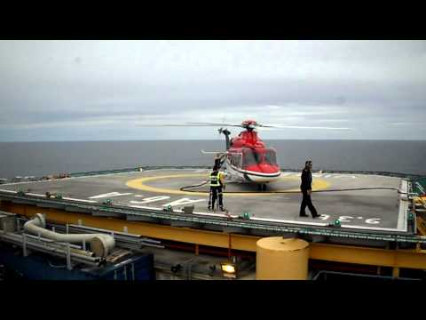 Helicopter landing, refuelling and take off at production platform A6-A