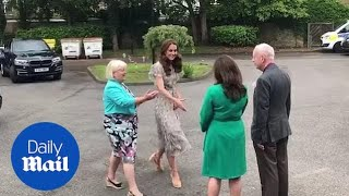 Kate arrives at Royal Photographic Society workshop in London