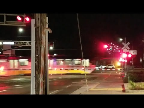 Mather Field Road Railroad Crossing, Sacramento Light Rail With Fireworks In Back, Rancho Cordova CA