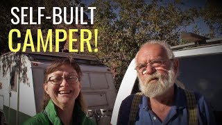 self-built-camper-happy-couple-travels-in-camping-trailer-built-from